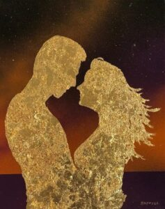 Man and woman in love embracing on the beach with windswept hair