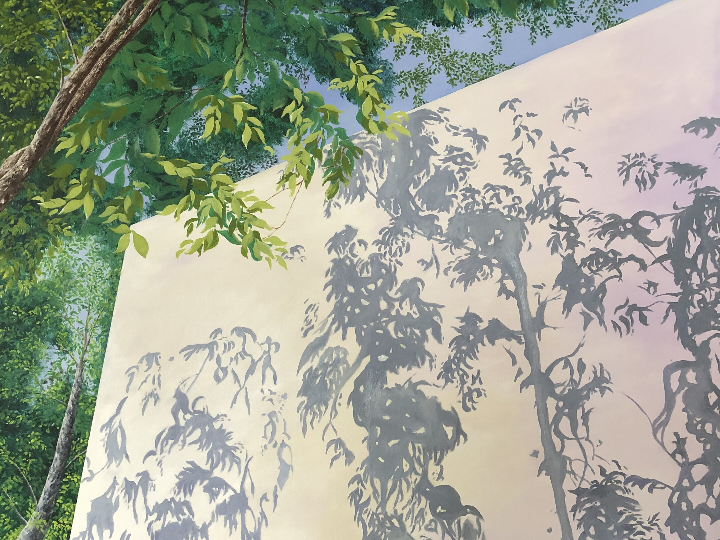 Blue sky, green leaves, brown trunks, white wall. gray shadows
